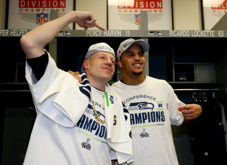 SEATTLE, WA - JANUARY 19:  Rapper Macklemore and wide receiver Jermaine Kearse #15 of the Seattle Seahawks celebrate in the locker room after the Seahawks 23-17 victory against the San Francisco 49ers during the 2014 NFC Championship at CenturyLink Field on January 19, 2014 in Seattle, Washington.  (Photo by Ronald Martinez/Getty Images) Photo: Getty Images