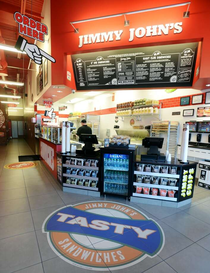 Large pointing fingers are on hand to guide customers through the line at Jimmy John's. Beaumont residents seem to be enjoying the speedy sandwiches available from the area's first Jimmy John's, located on Dowlen Road. Photo taken Wednesday, 1/8/14 Jake Daniels/@JakeD_in_SETX