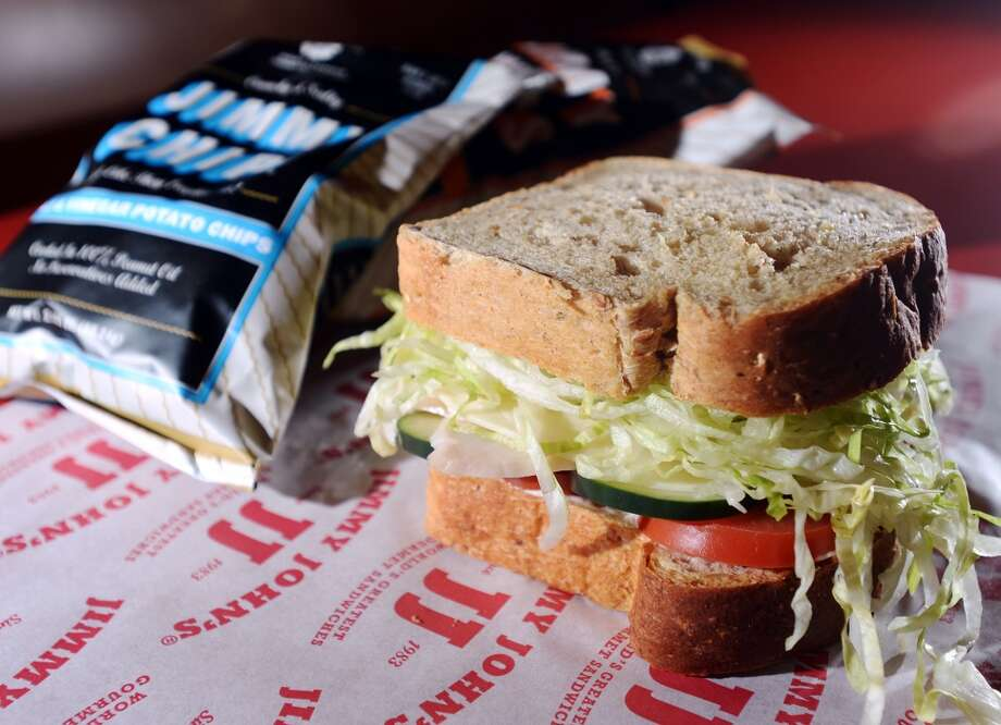 Pictured is a #12 Beach Club on seven-grain wheat bread, accompanied by bags of Jimmy John's chips. Beaumont residents seem to be enjoying the speedy sandwiches available from the area's first Jimmy John's, located on Dowlen Road. Photo taken Wednesday, 1/8/14 Jake Daniels/@JakeD_in_SETX