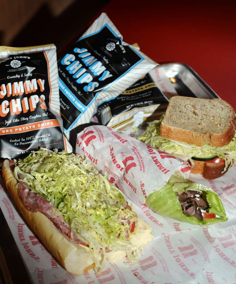 Pictured are, left to right, a #9 Italian Night Club on French bread, a #10 Hunter's Club un-wich, and a #12 Beach Club on seven-grain wheat bread. Beaumont residents seem to be enjoying the speedy sandwiches available from the area's first Jimmy John's, located on Dowlen Road. Photo taken Wednesday, 1/8/14 Jake Daniels/@JakeD_in_SETX