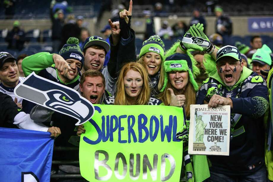 Seattle Seahawks fans celebrate after the Seahawks defeated the San Francisco 49ers for the NFC Championship at CenturyLink Field on Sunday, January 19, 2014. Photo: JOSHUA TRUJILLO, SEATTLEPI.COM / SEATTLEPI.COM