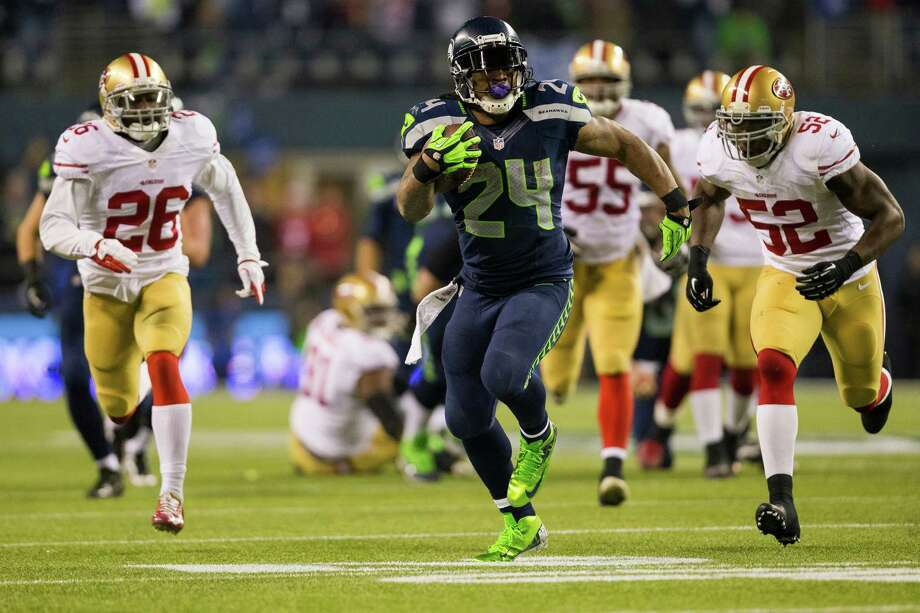 Seahawks running back Marshawn Lynch, center, pushes through 49ers defense during the first half of the NFC Championship game Sunday, Jan. 19, 2014, at CenturyLink Field in Seattle. Photo: JORDAN STEAD, SEATTLEPI.COM / SEATTLEPI.COM