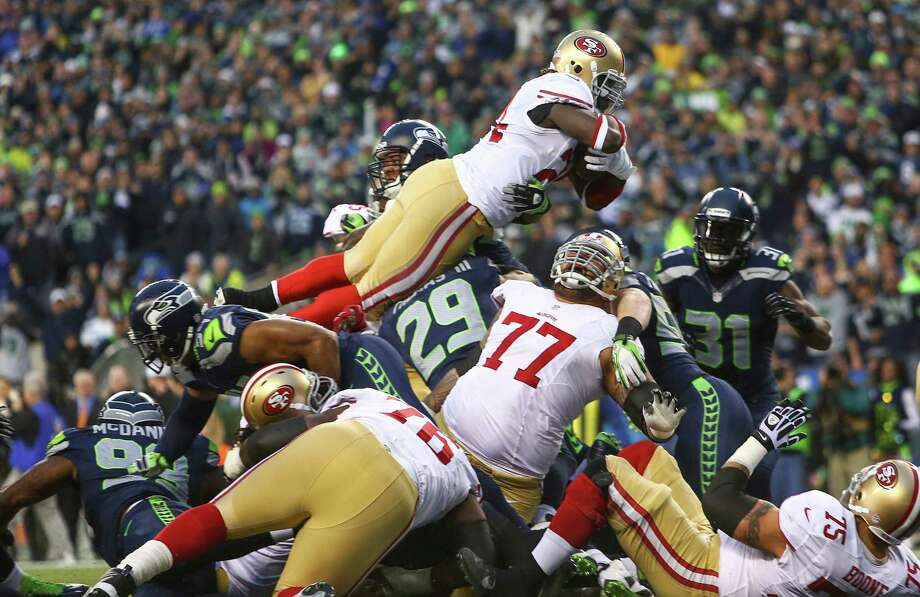 San Francisco 49ers player Anthony Dixon leaps into the end zone for a touchdown against the Seahawks during the NFC Championship game at CenturyLink Field on Sunday, January 19, 2014. Photo: JOSHUA TRUJILLO, SEATTLEPI.COM / SEATTLEPI.COM