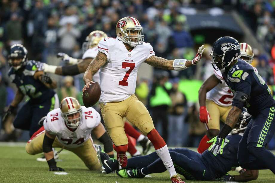 San Francisco 49ers quarterback Colin Kaepernick tries to fend off the Seahawks defense during the NFC Championship game at CenturyLink Field on Sunday, January 19, 2014. Photo: JOSHUA TRUJILLO, SEATTLEPI.COM / SEATTLEPI.COM