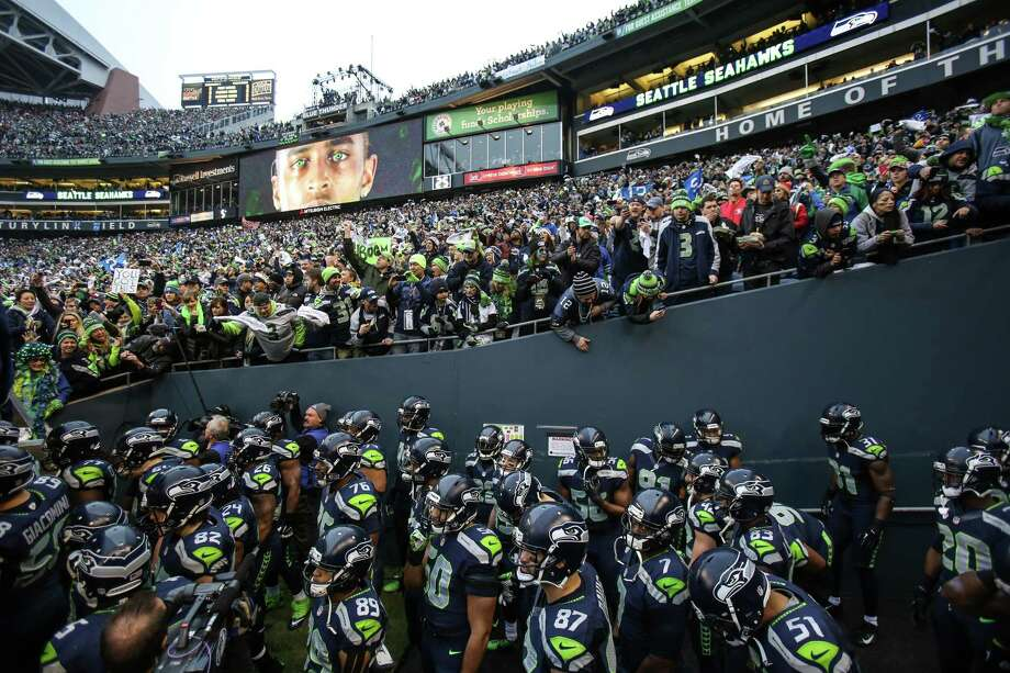 Seattle Seahawks players prepare to take the field against the San Francisco 49ers during the NFC Championship game at CenturyLink Field on Sunday, January 19, 2014. Photo: JOSHUA TRUJILLO, SEATTLEPI.COM / SEATTLEPI.COM