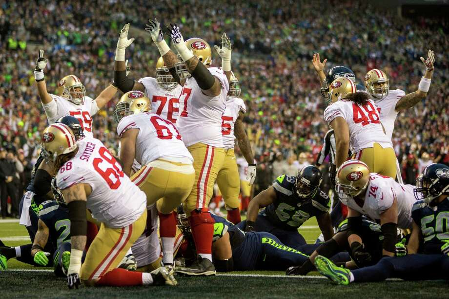San Francisco 49ers players rejoice following their first touchdown during the first half of the NFC Championship game against the Seahawks Sunday, Jan. 19, 2014, at CenturyLink Field in Seattle. Photo: JORDAN STEAD, SEATTLEPI.COM / SEATTLEPI.COM