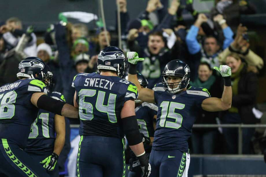 Seattle Seahawks players celebrate a touchdown by Jermaine Kearse in the 4th quarter against the San Francisco 49ers at CenturyLink Field on Sunday, January 19, 2014. Photo: JOSHUA TRUJILLO, SEATTLEPI.COM / SEATTLEPI.COM