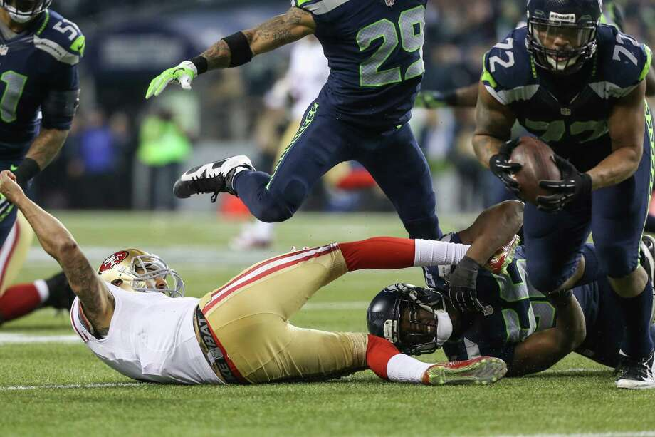 Seattle Seahawks player Michael Bowie recovers a ball knocked away from San Francisco 49ers quarterback Colin Kaepernick during the NFC Championship game at CenturyLink Field on Sunday, January 19, 2014. Photo: JOSHUA TRUJILLO, SEATTLEPI.COM / SEATTLEPI.COM