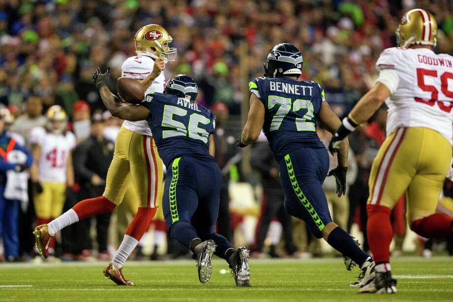 Seahawk Cliff Avril, center left, sacks 49ers' quarterback Colin Kaepernick, left, during the second half of the NFC Championship game Sunday, Jan. 19, 2014, at CenturyLink Field in Seattle. The Seahawks beat the 49ers 23-17 and will face off against the Denver Broncos in the Super Bowl on Feb. 2. Photo: JORDAN STEAD, SEATTLEPI.COM / SEATTLEPI.COM