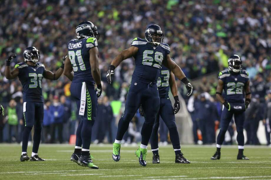 The Seattle Seattle Seahawks defensive line gets hyped up against the San Francisco 49ers during the NFC Championship game at CenturyLink Field on Sunday, January 19, 2014. Photo: JOSHUA TRUJILLO, SEATTLEPI.COM / SEATTLEPI.COM