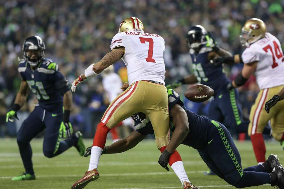 Seattle Seahawks player Cliff Avril knocks the ball from San Francisco 49ers quarterback Colin Kaepernick for a turnover during the NFC Championship game at CenturyLink Field on Sunday, January 19, 2014. Photo: JOSHUA TRUJILLO, SEATTLEPI.COM / SEATTLEPI.COM