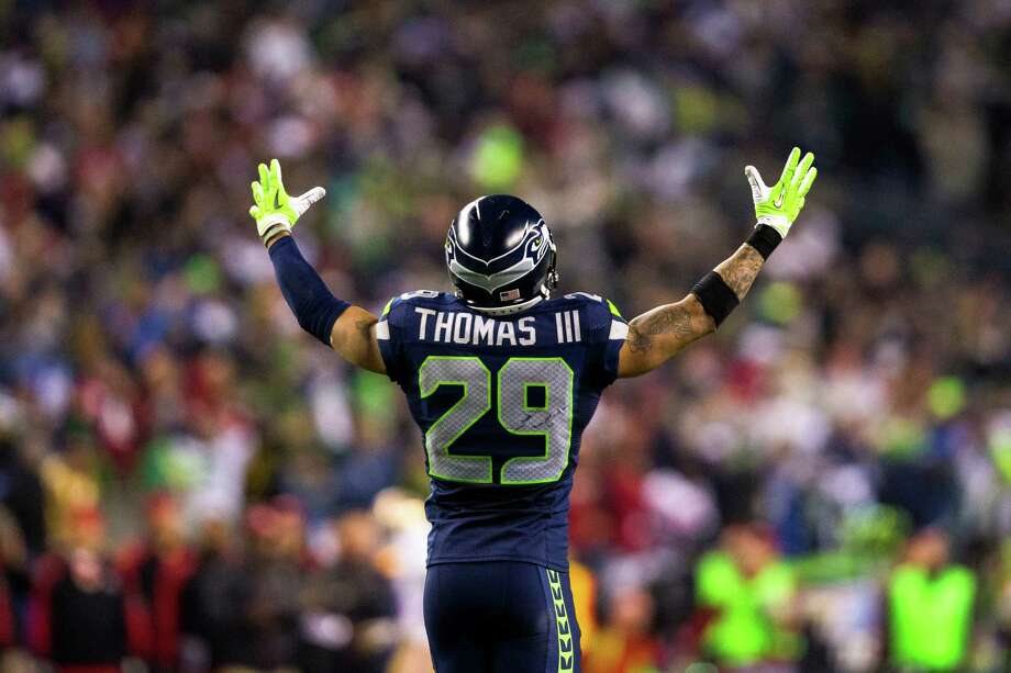 Earl Thomas rallies the crowd during the second half of the NFC Championship game Sunday, Jan. 19, 2014, at CenturyLink Field in Seattle. The Seahawks beat the 49ers 23-17 and will face off against the Denver Broncos in the Super Bowl on Feb. 2. Photo: JORDAN STEAD, SEATTLEPI.COM / SEATTLEPI.COM