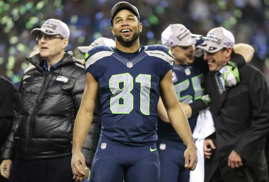 Seattle Seahawks player Golden Tate watches from the stage as the team celebrates their NFC Championship win over the San Francisco 49ers at CenturyLink Field on Sunday, January 19, 2014. Photo: JOSHUA TRUJILLO, SEATTLEPI.COM / SEATTLEPI.COM