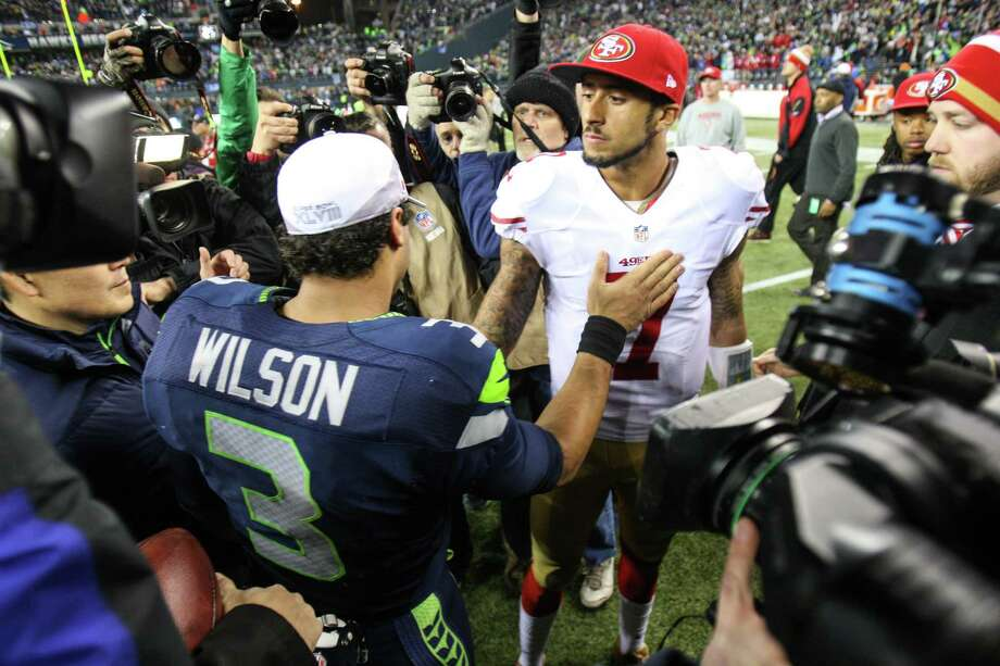 Seattle Seahawks quarterback Russell Wilson and San Francisco 49ers quarterback Colin Kaepernick meet midfield after the Seahawks won the NFC Championship  at CenturyLink Field on Sunday, January 19, 2014. Photo: JOSHUA TRUJILLO, SEATTLEPI.COM / SEATTLEPI.COM