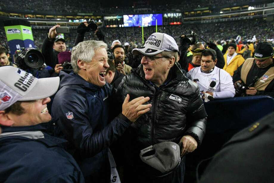 Seattle Seahawks coach Pete Carroll celebrates with team owner Paul Allen after the Seahawks beat the San Francisco 49ers for the NFC Championship at CenturyLink Field on Sunday, January 19, 2014. Photo: JOSHUA TRUJILLO, SEATTLEPI.COM / SEATTLEPI.COM
