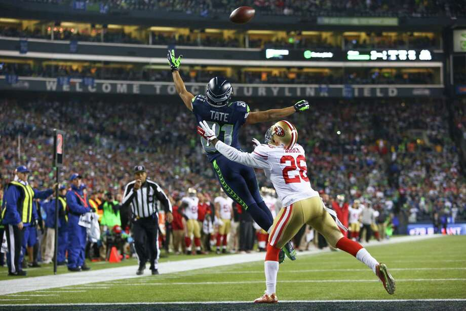 Seattle Seahawks player Golden Tate goes up for a pass while defended by San Francisco 49ers player Tramaine Brock during the NFC Championship game at CenturyLink Field on Sunday, January 19, 2014. Photo: JOSHUA TRUJILLO, SEATTLEPI.COM / SEATTLEPI.COM