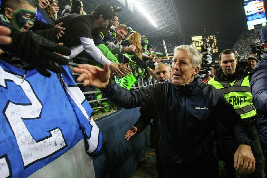 Seattle Seahawks coach Pete Carroll is greeted by fans after the Seahawks defeated the San Francisco 49ers for the NFC Championship at CenturyLink Field on Sunday, January 19, 2014. Photo: JOSHUA TRUJILLO, SEATTLEPI.COM / SEATTLEPI.COM