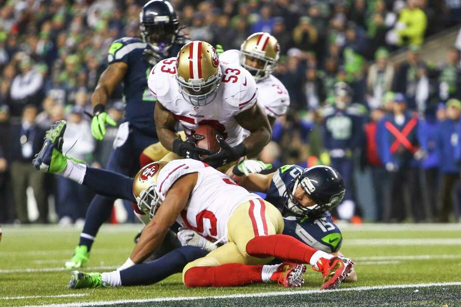 San Francisco 49ers player NaVorro Bowman comes down at the goal line and is injured during the NFC Championship game at CenturyLink Field on Sunday, January 19, 2014. Photo: JOSHUA TRUJILLO, SEATTLEPI.COM / SEATTLEPI.COM