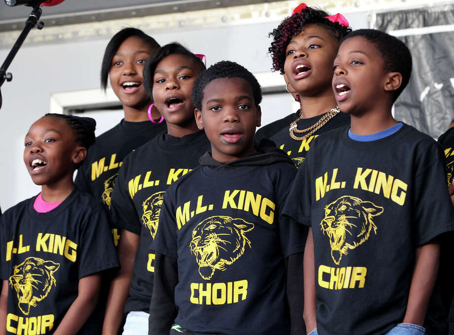 Students from the Martin Luther King Academy sing before the MLK march in San Antonio Monday January 20, 2014. Photo: JOHN DAVENPORT, SAN ANTONIO EXPRESS-NEWS / ©San Antonio Express-News/Photo may be sold to the public