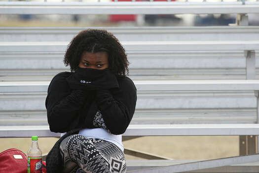 Tiana Johnson, 14, waits for the start of the Martin Luther King Commemorative Program at Pittman-Sullivan Park, Monday, Jan. 20, 2014. Photo: Jerry Lara, San Antonio Express-News / ©2013 San Antonio Express-News