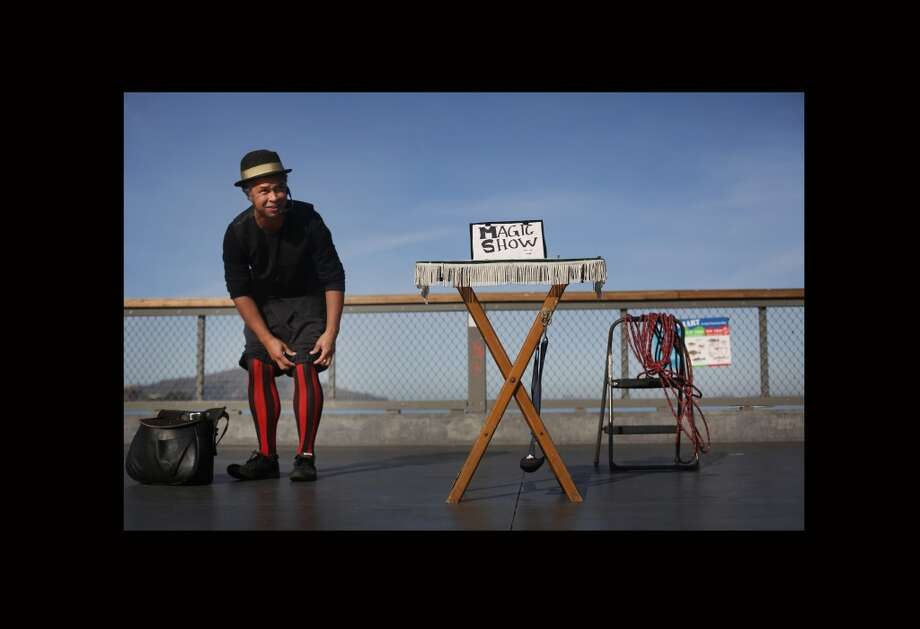 Caging the crowd potential, Lynx the Animator sets the stage for his magic and comedy routine at Fisherman's Wharf in San Francisco on Friday Jan. 10, 2014. Photo: Mike Kepka, The Chronicle