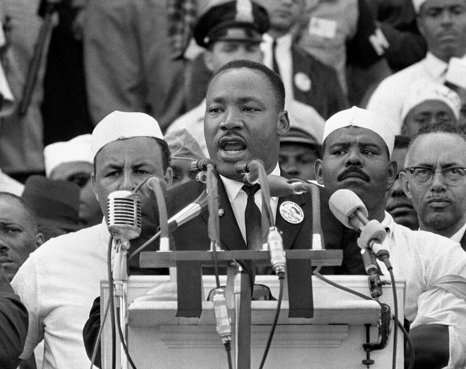 "In this Aug. 28, 1963, black-and-white file photo Dr. Martin Luther King Jr., head of the Southern Christian Leadership Conference, addresses marchers during his ""I Have a Dream"" speech at the Lincoln Memorial in Washington. (AP Photo/File) / AP1963"