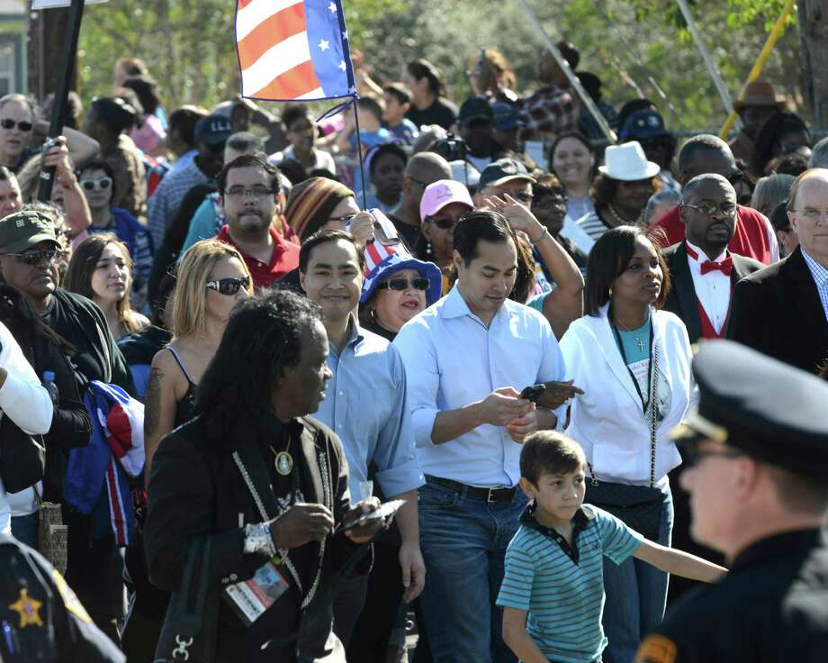 Rep. Joaquin Castro, left, and Mayor Juilian Castro walk during the San Antonio Martin Luther King Jr. March on Monday, Jan. 20, 2014. Photo: Billy Calzada, San Antonio Express-News / San Antonio Express-News