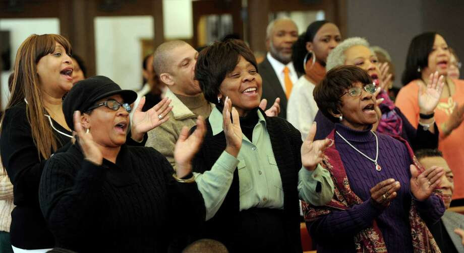 """From left, Kim Brown, Carrie Anderson and Pearl Torian join in singing """" Happy Birthday,""""  Stevie Wonder's song first written to advocate for making King's birthday a holiday. New Hope Baptist Church in Danbury, Conn., holds it's 12th annual celebration honoring Dr. Martin Luther King Jr., Monday, January 20, 2014. Photo: Carol Kaliff / The News-Times"""