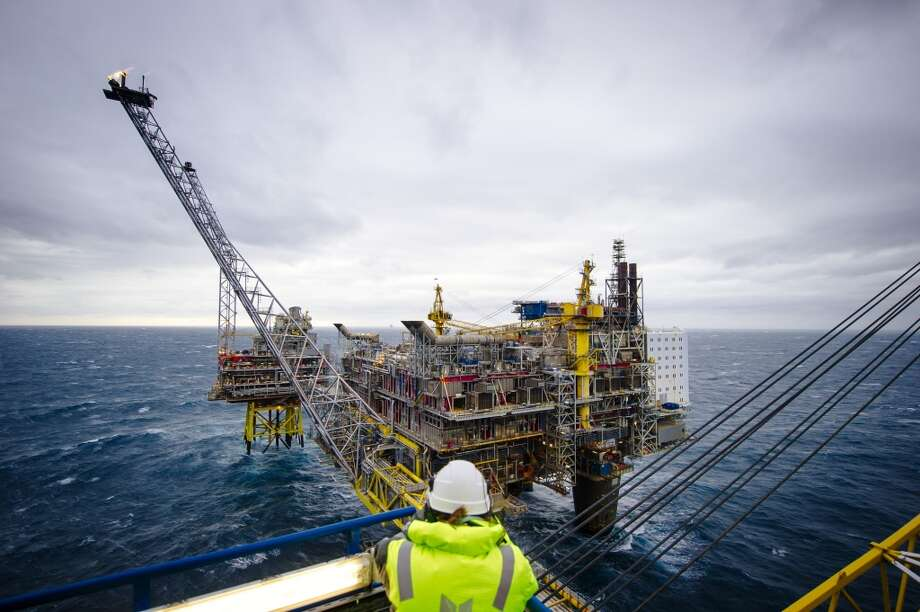 A visitor looks out towards a flare stack on the Oseberg A offshore gas platform operated by Statoil ASA in the North Sea 140 kilometers  (87 miles) from Bergen, Norway, on Friday, Jan. 17, 2014. Photo: Kristian Helgesen, Bloomberg