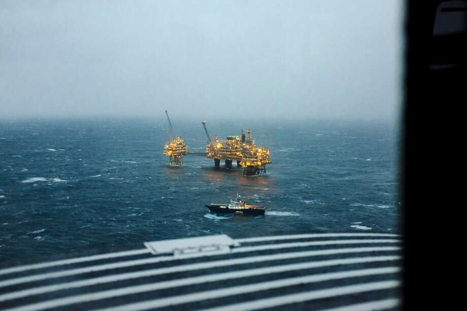 The Oseberg A offshore gas platform operated by Statoil ASA stands illuminated in the North Sea as a vessel passes 140 kilometers  (87 miles) from Bergen, Norway, on Friday, Jan. 17, 2014. Photo: Kristian Helgesen, Bloomberg