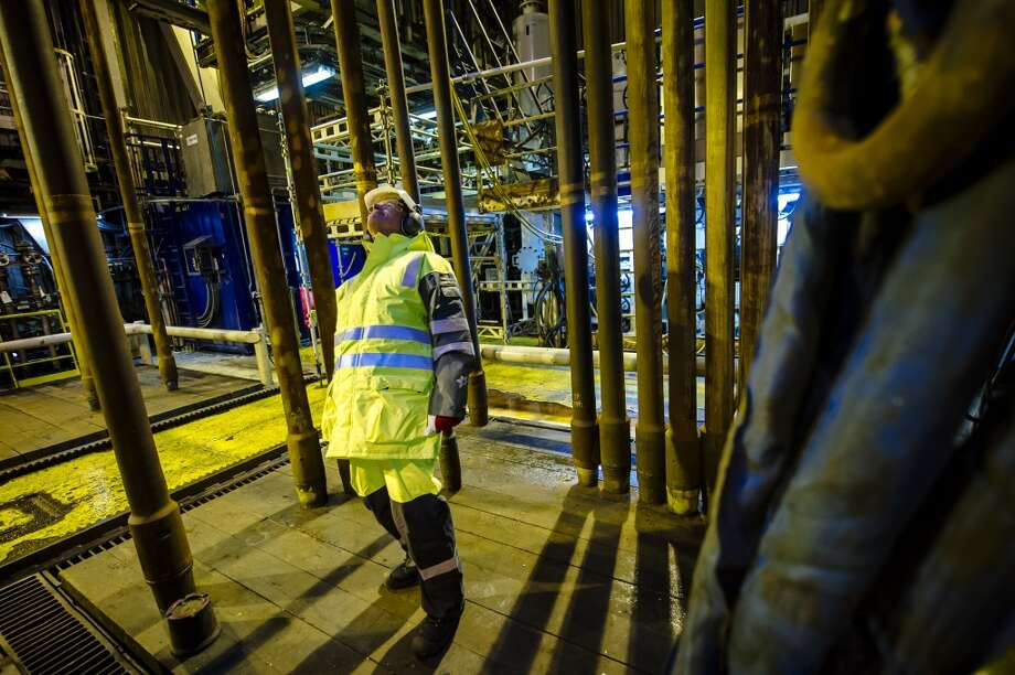 Kjetil Hove, vice president of development and production for the east region at Statoil ASA, inspects pipework on the Oseberg A offshore gas platform operated by Statoil ASA in the Oseberg oil field 140 kilometers  (87 miles) from Bergen, Norway, on Friday, Jan. 17, 2014. Photo: Kristian Helgesen, Bloomberg