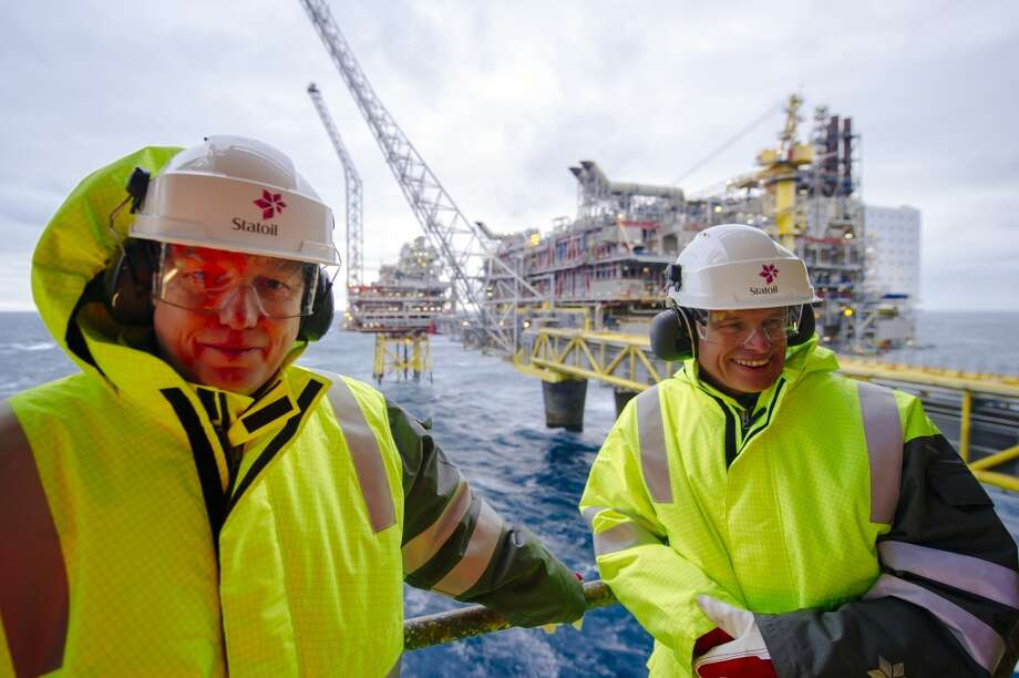 Arne Sigve Nylund, vice president for development and production in Norway for Statoil ASA, right, and Kjetil Hove, vice president of development and production for the east region at Statoil ASA, pause during a tour of the Oseberg A North Sea offshore gas platform, operated by Statoil, 140 kilometers  (87 miles) from Bergen, Norway, on Friday, Jan. 17, 2014. Photo: Kristian Helgesen, Bloomberg