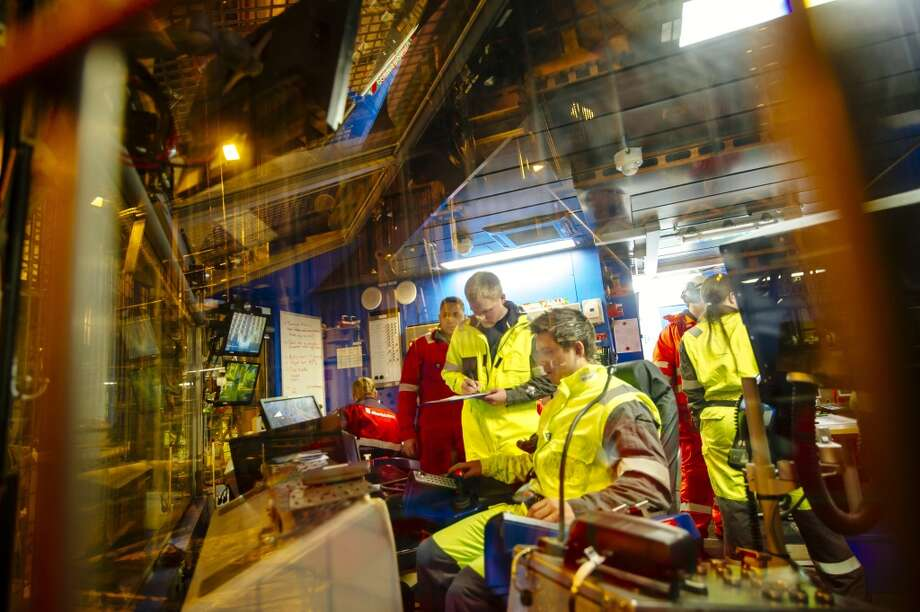 Workers test new equipment in the drilling control room on the Oseberg A North Sea offshore gas platform operated by Statoil ASA 140 kilometers  (87 miles) from Bergen, Norway, on Friday, Jan. 17, 2014. Photo: Kristian Helgesen, Bloomberg