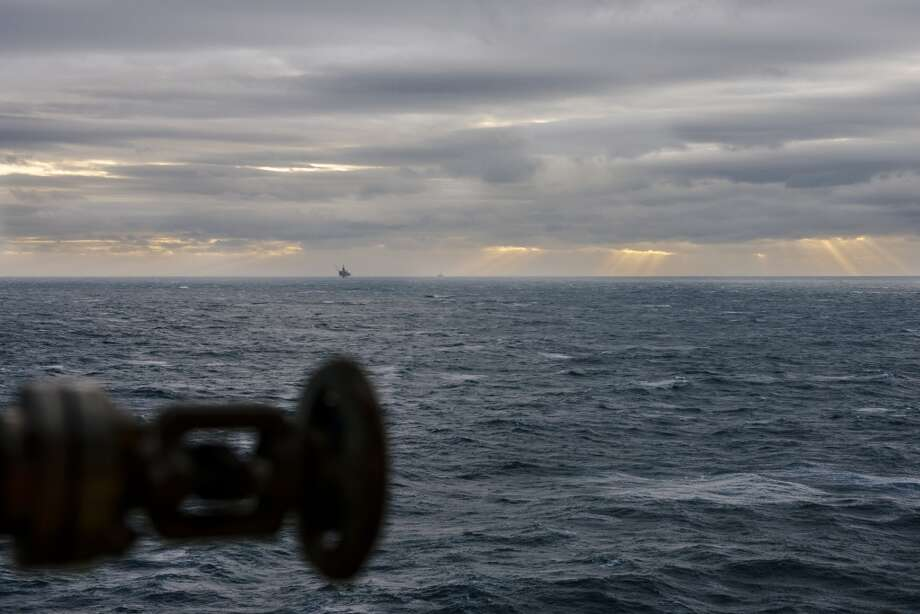 Drilling rigs stand on the horizon in the Oseberg North Sea oil field seen from the Oseberg A offshore gas platform operated by Statoil ASA 140 kilometers  (87 miles) from Bergen, Norway, on Friday, Jan. 17, 2014. Photo: Kristian Helgesen, Bloomberg