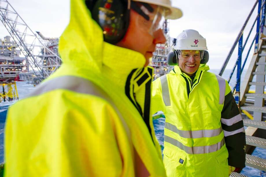 Arne Sigve Nylund, vice president for development and production in Norway for Statoil ASA, right, and Kjetil Hove, vice president of development and production for the east region at Statoil ASA, pause during a tour of the Oseberg A offshore gas platform, operated by Statoil, 140 kilometers  (87 miles) from Bergen, Norway, on Friday, Jan. 17, 2014. Photo: Kristian Helgesen, Bloomberg