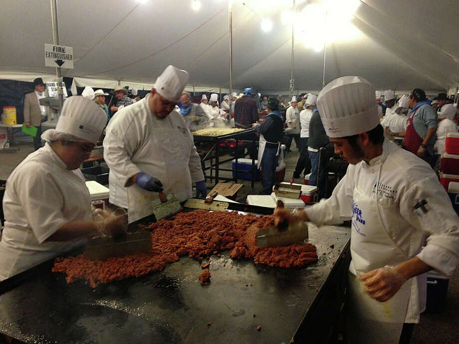 10,000 Rudy's BBQ beef tacosWorkers prepare the fixings for tacos during the 35th annual Cowboy Breakfast at Cowboys Dancehall on Jan. 25, 2013. Photo: Billy Calzada, San Antonio Express-News / SAN ANTONIO EXPRESS-NEWS