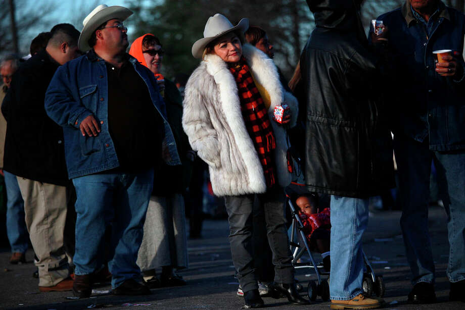 More than 30 minute wait timesOdilia O'Neal (center), who has attended the Cowboy Breakfast for 23 years, waits in line for tacos at Cowboys Dancehall on Jan. 28, 2011. The food ran out, so O'Neal only had coffee and milk. Photo: LISA KRANTZ, San Antonio Express-News / SAN ANTONIO EXPRESS-NEWS
