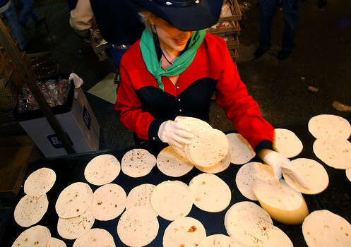 "Tortillas (tohr-TEE-yahs): If you live in San Antonio, you better know how to pronounce tortilla, the flat unleavened bread that is a staple of Mexico. Audio: Click here to hear the term ""Tortillas."" Photo: KIN MAN HUI, San Antonio Express-News / SAN ANTONIO EXPRESS-NEWS"