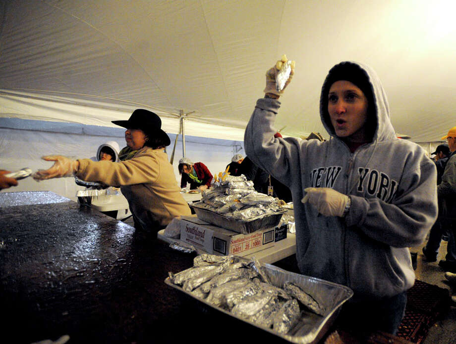 10,000 Delicious tamalesHerlinda Lopez call for people to come and get their tacos during the annual Cowboy Breakfast at Cowboys Dancehall on Jan. 29, 2010. Photo: BILLY CALZADA, San Antonio Express-News / gcalzada@express-news.net