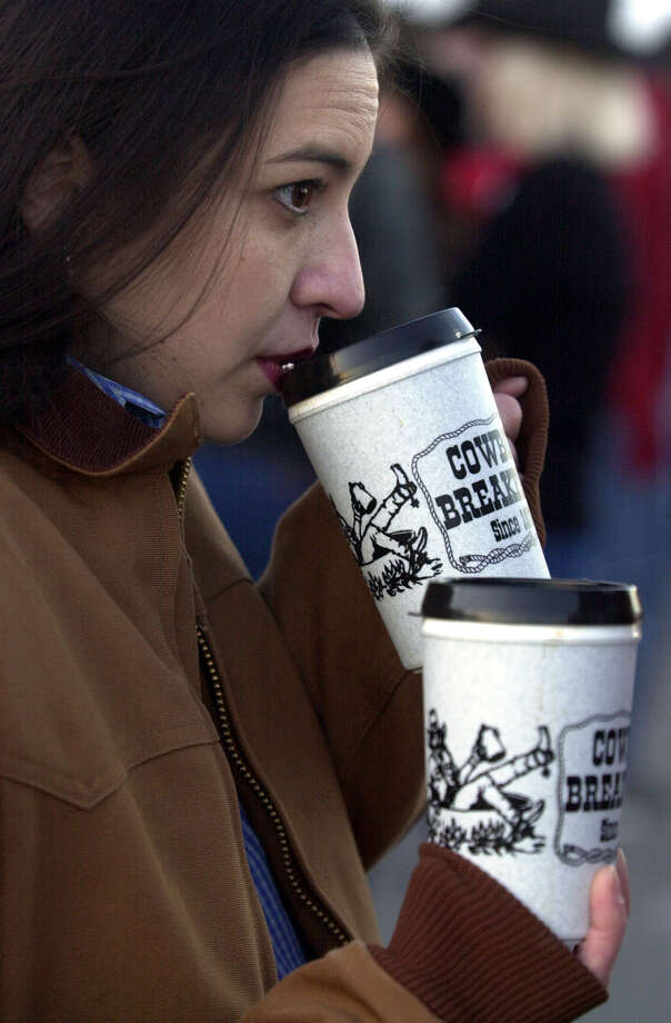 5,000 pints of Oak Farms milk and orange juiceRichelle Clements sips coffee to stay warm during the annual Cowboy Breakfast at the Far West Rodeo on Jan. 25, 2002. Photo: KAREN L. SHAW, San Antonio Express-News / SAN ANTONIO EXPRESS-NEWS