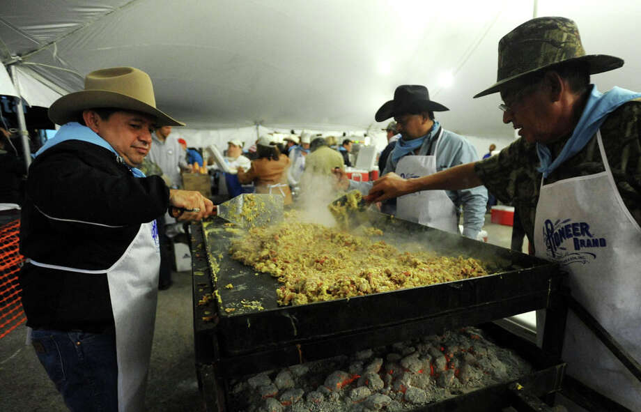 San Antonio's Cowboy Breakfast is known for its early start, its often bad weather and its sheer volume of, well, everything! Here's a look at the numbers that go into making the Alamo City's favorite free breakfast.The 2015 Cowboy Breakfast will be Friday, Jan. 30, from 4:30 a.m. to 8:30 a.m. in front of Cowboys Dancehall, 3030 N.E. Loop 410. Sources: Cowboy Breakfast and San Antonio Express-News archives Photo: Billy Calzada, San Antonio Express-News / San Antonio Express-News