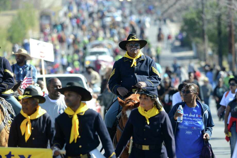 Alfonso Hudson of the Buffalo Soldiers rides during the San Antonio Martin Luther King Jr. March on Monday, Jan. 20, 2014. Photo: Billy Calzada, San Antonio Express-News / San Antonio Express-News