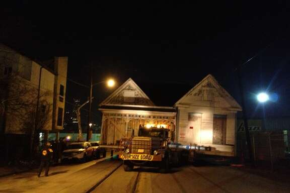 House moves down Commerce Street.