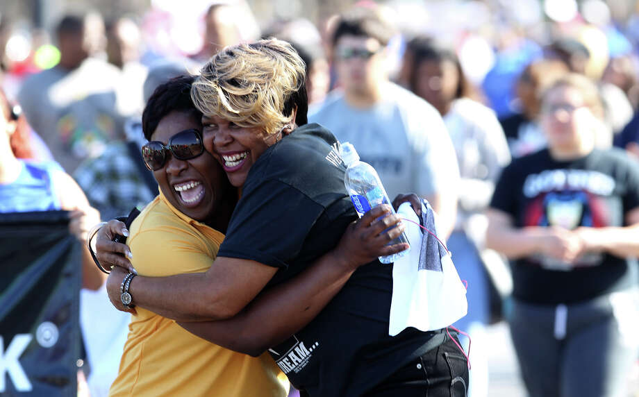 Jody Roberts (left) and Kathy Thompson embrace Monday January 20, 2014 while taking part in the Martin Luther King march in San Antonio. Photo: JOHN DAVENPORT, SAN ANTONIO EXPRESS-NEWS / ©San Antonio Express-News/Photo may be sold to the public