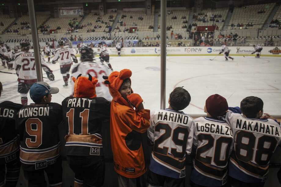 Ian Holland watches players warm up during the San Francisco Bulls opening night match against the Bakersfield Condors at Cow Palace in San Francisco on November 8th 2013. Photo: Special To The Chronicle