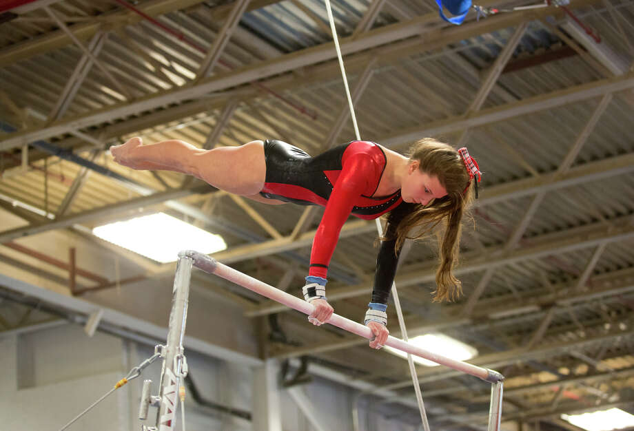 Warde's Tori Gallati competes on the uneven bars during the gymnastic meet against Ludlowe High School at Gymnastics & Cheer Academy in Fairfield on Monday, Jan. 20, 2014. Photo: Amy Mortensen / Connecticut Post Freelance