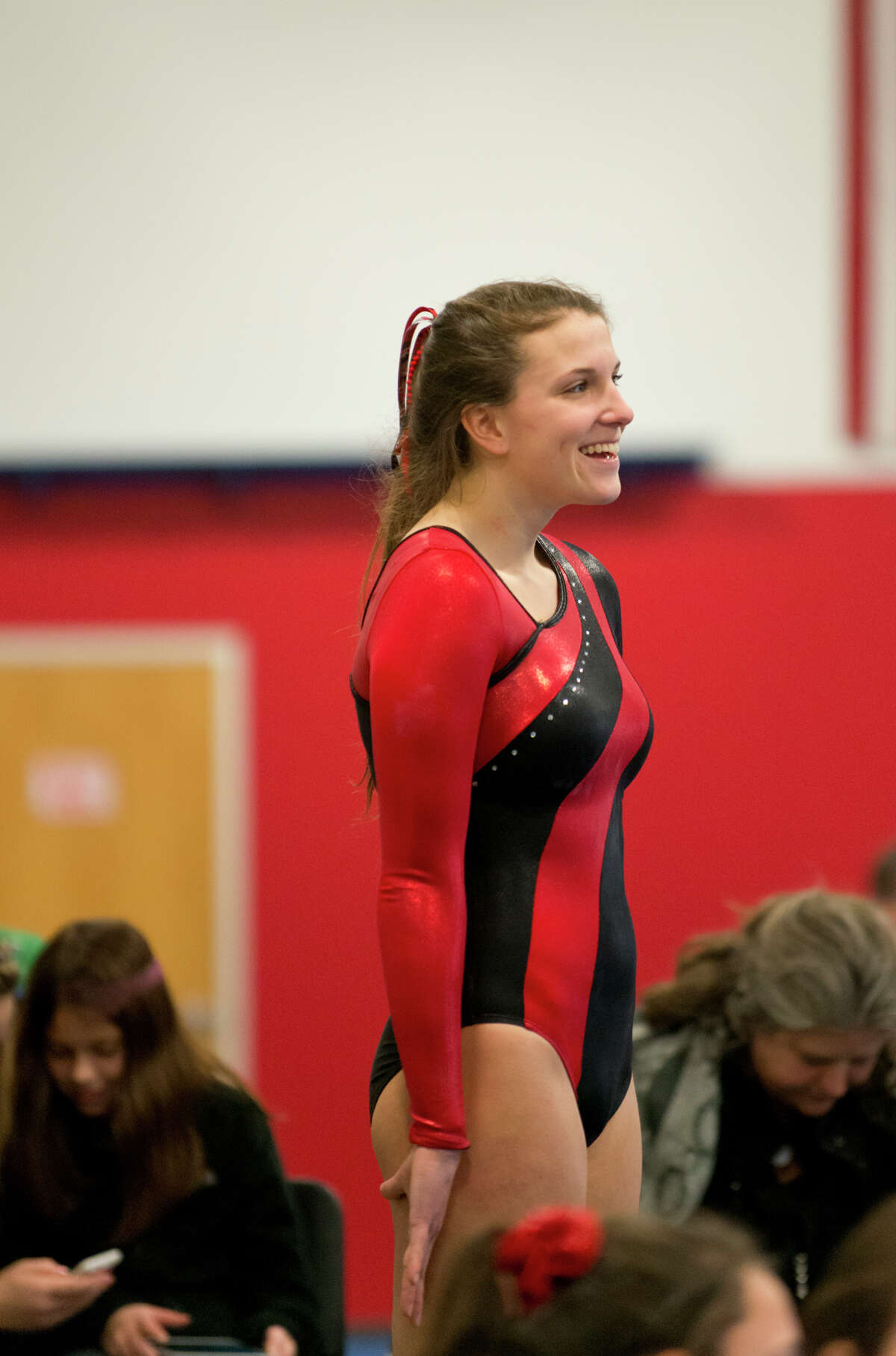 Warde's Tori Gallati smiles during the gymnastic meet against Ludlowe High School at Gymnastics & Cheer Academy in Fairfield on Monday, Jan. 20, 2014.