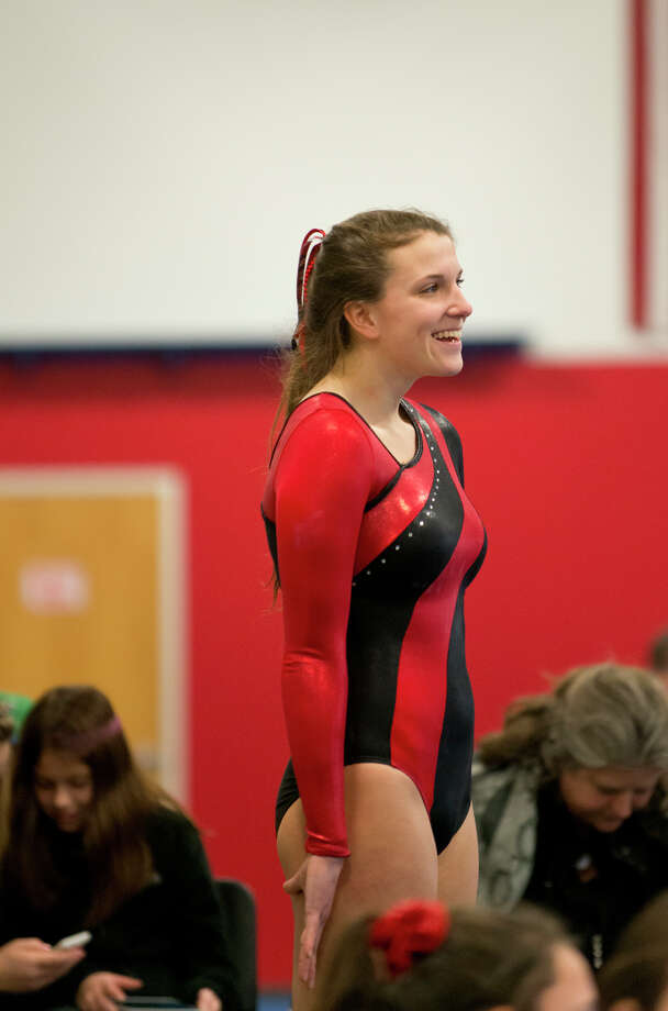 Warde's Tori Gallati smiles during the gymnastic meet against Ludlowe High School at Gymnastics & Cheer Academy in Fairfield on Monday, Jan. 20, 2014. Photo: Amy Mortensen / Connecticut Post Freelance