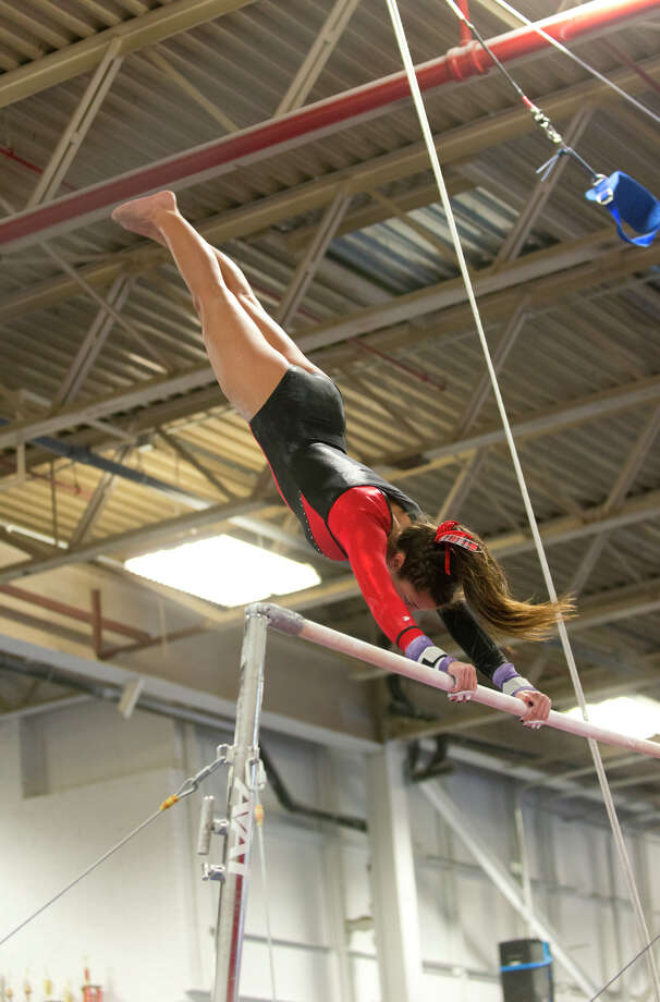 Warde's Kathleen Pisciotta competes on the uneven bars during the gymnastic meet against Ludlowe High School at Gymnastics & Cheer Academy in Fairfield on Monday, Jan. 20, 2014. Photo: Amy Mortensen / Connecticut Post Freelance