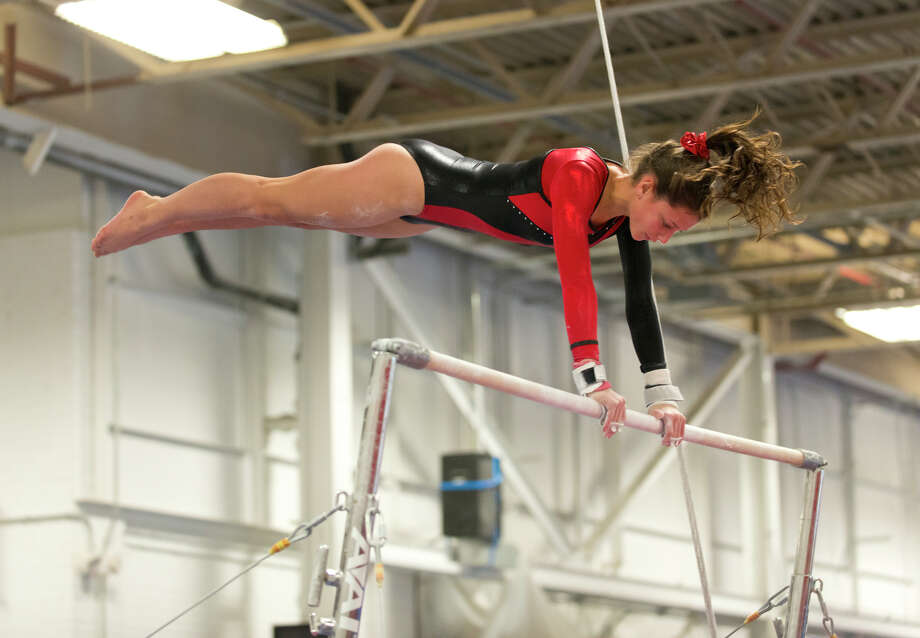 Warde's Sophia Mancini competes on the uneven bars during the gymnastic meet against Ludlowe High School at Gymnastics & Cheer Academy in Fairfield on Monday, Jan. 20, 2014. Photo: Amy Mortensen / Connecticut Post Freelance